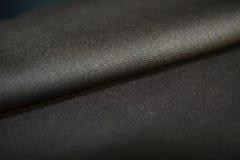 Sluit omhoog de bruine stof van de broodjestextuur van kostuum Royalty-vrije Stock Foto's