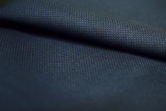 Sluit omhoog de donkerblauwe stof van de patroontextuur van kostuum Royalty-vrije Stock Fotografie