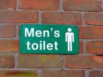 sluit omhoog de muur van het het toiletteken van groene en witte mensen royalty-vrije stock afbeeldingen
