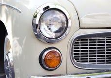 Sluit omhoog foto van koplamp retro auto royalty-vrije stock afbeelding