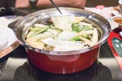Sluit omhoog gezond voedsel op rode pot van hoge hoekmening Stock Afbeelding