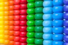 Sluit omhoog kleurrijk telraam, oud calculatorstuk speelgoed Stock Foto