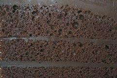 Sluit omhoog laag van de donkere textuur van de chocoladecake Stock Afbeelding