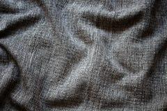 Sluit omhoog mening van de verfrommelde, grijze achtergrond van de wolstof royalty-vrije stock foto