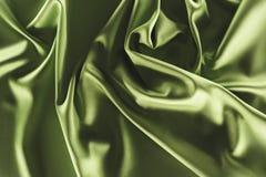 sluit omhoog mening van elegante groene zijdedoek stock foto