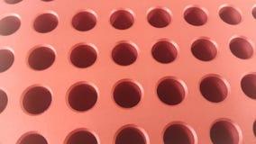 Sluit omhoog mening van gaten in gouden micro- pipetdoos in onderzoeklaboratorium royalty-vrije stock foto's