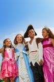 Sluit omhoog mening van jonge geitjes in verschillende kostuums Royalty-vrije Stock Foto's