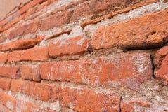 Sluit omhoog olden bakstenen uitstekende muur Stock Fotografie