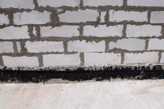 Sluit omhoog op Belangrijke het Waterdicht maken Opties voor Concrete Stichtingen stock afbeelding