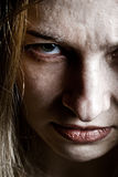Sluit omhoog op boos kwaad verstoord eng gezicht stock fotografie