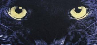 Sluit omhoog op de ogen van een zwarte panter op stof Stock Afbeelding