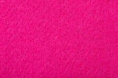 Sluit omhoog op roze gevoelde textuur als achtergrond stock foto