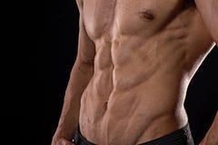 Sluit omhoog perfecte abs Sexy spier mannelijk torso zes pakken Stock Afbeelding