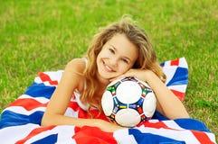 Sluit omhoog portret van leuk weinig meisje van de voetbalventilator Royalty-vrije Stock Fotografie