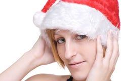 Sluit omhoog portret van meisje in de hoed van de Kerstman Royalty-vrije Stock Afbeeldingen