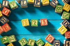Sluit omhoog regeling van alfabet Stock Foto's