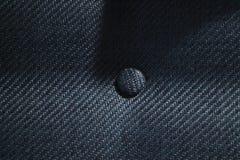 Sluit omhoog stoffentextuur van beklede luxeleunstoel Premie het stikken en crosshatched patroon op bankoppervlakte stock foto's