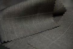 Sluit omhoog textuur bruin met witte lijnstof van kostuum Royalty-vrije Stock Foto