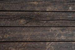 Sluit omhoog textuurachtergrond van oude donkere houten die raad horizontaal in een muur wordt geschikt Royalty-vrije Stock Afbeeldingen