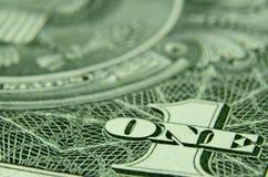 Sluit omhoog van ÉÉN en 1 van een Amerikaanse dollarrekening royalty-vrije stock afbeeldingen