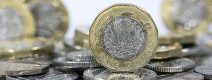 Sluit omhoog van Één Pondmuntstukken - Britse Munt Royalty-vrije Stock Foto's