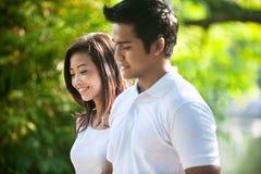Sluit omhoog van aantrekkelijk Aziatisch paar Stock Foto's