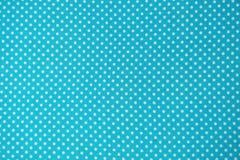Sluit omhoog van blauwe stof met wit stippatroon stock illustratie