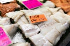 Sluit omhoog van de filets van het kabeljauwlendestuk met een ingekapselde lichtgevende orang-oetan royalty-vrije stock foto's