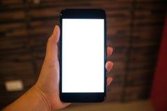 Sluit omhoog van van de de handenbewaarcel van vrouwen de telefoon leeg exemplaar spac stock afbeelding