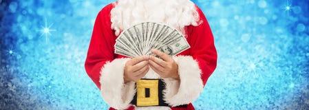 Sluit omhoog van de Kerstman met dollargeld Royalty-vrije Stock Foto's