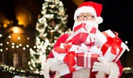 Sluit omhoog van de Kerstman met Kerstmisgiften Stock Fotografie