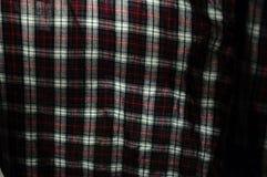 Sluit omhoog van de textuur van de stoffenplaid Geometrische Achtergrond Donkere cru Stock Foto