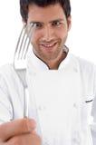 Sluit omhoog van de vork van de chef-kokholding stock afbeelding