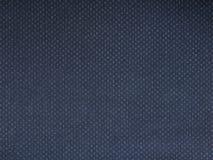 Sluit omhoog van donkerblauwe linnentextuur, nuttig als achtergrondfoto Stock Fotografie