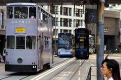 Sluit omhoog van drie trams die in einde op Hong Kong Island trekken, stock foto's