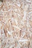 Sluit omhoog van een kringloop samengeperste houten oppervlakte Stock Afbeelding