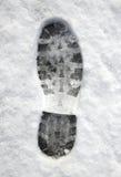 Sluit omhoog van een voetafdruk in de sneeuw. Stock Afbeeldingen