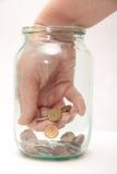 Sluit omhoog van een wijfje dat geld met de hand plukt royalty-vrije stock afbeeldingen