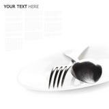 Sluit omhoog van een zilveren lepel en een vork op een witte achtergrond Royalty-vrije Stock Foto