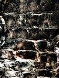 Sluit omhoog van een zwarte bakstenen muur Stock Foto