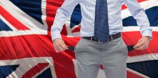 Sluit omhoog van Engelse zakenman met lege zakken stock afbeeldingen