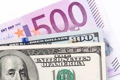 Sluit omhoog van euro en dollars op witte achtergrond Royalty-vrije Stock Foto's