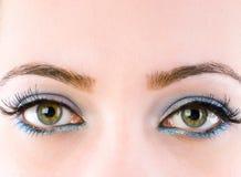 Sluit omhoog van gezicht met make-up Stock Afbeelding