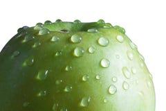 Sluit omhoog van groene appel met waterdruppeltjes Royalty-vrije Stock Afbeelding
