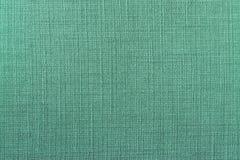Sluit omhoog van groene stoffentextuur royalty-vrije stock afbeelding