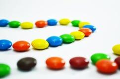 Sluit omhoog van Kleurrijk Suikergoed met het Knippen van Weg Royalty-vrije Stock Fotografie