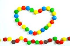 Sluit omhoog van Kleurrijk Suikergoed met het Knippen van Weg Stock Fotografie