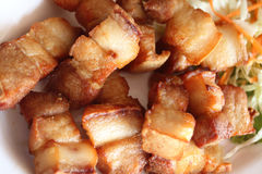 Sluit omhoog van Knapperig gebraden gestreept varkensvleesrecept Royalty-vrije Stock Foto