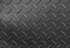Sluit omhoog van korrelige geweven staalplaat met het patroon van de diamantplaat, metaalachtergrond stock fotografie