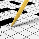 Sluit omhoog van kruiswoordraadsel met pen Stock Foto